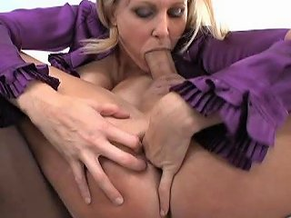 She Has Her Man Bend Over To Take A Strap In His Anal